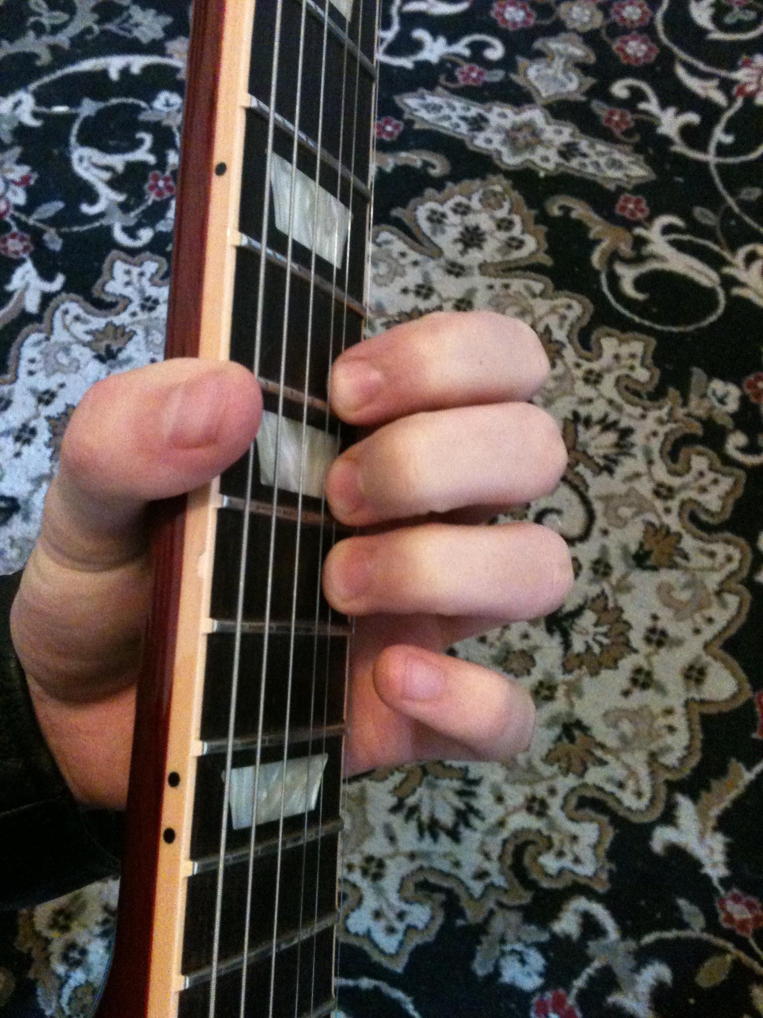 Holding The Neck For Vibrato